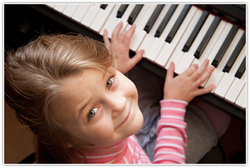 Image of child practicing piano